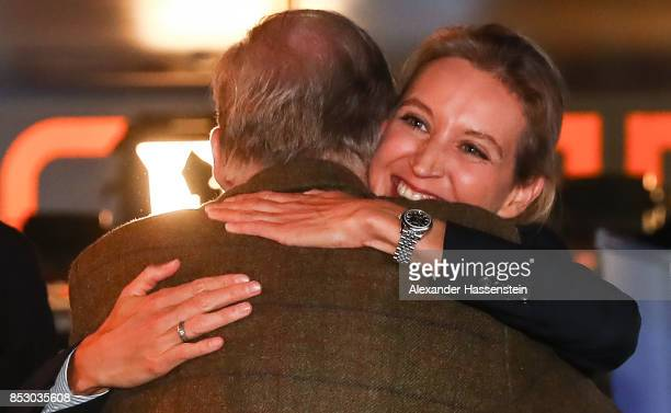 Alice Weidel and Alexander Gauland colead candidates of the Alternative for Germany celebrate after the announcement of the initial results that give...