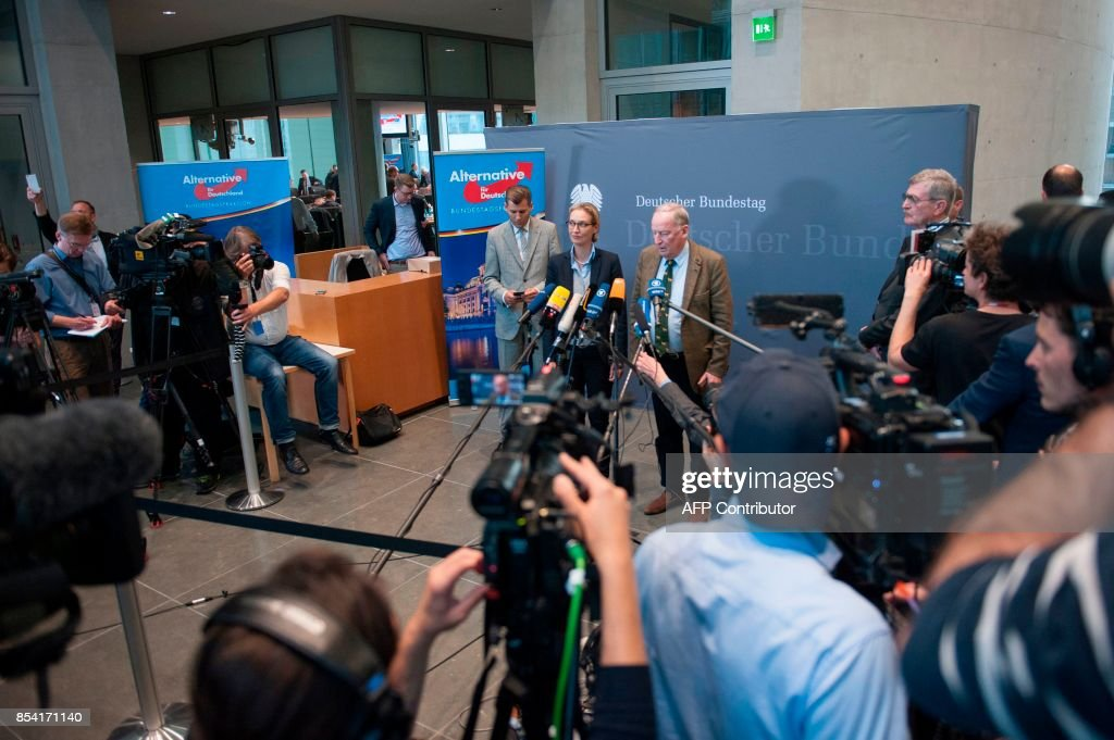 Alice Weidel and Alexander Gauland, newly elected parliamentary party leaders ofthe hard-right Alternative for Germany (AfD) party, make a statement after a first meeting of the AfD's parliamentary group at the Marie-Elisabeth-Lueders-Haus parliamentary building in Berlin on September 26, 2017, two days after general elections. /