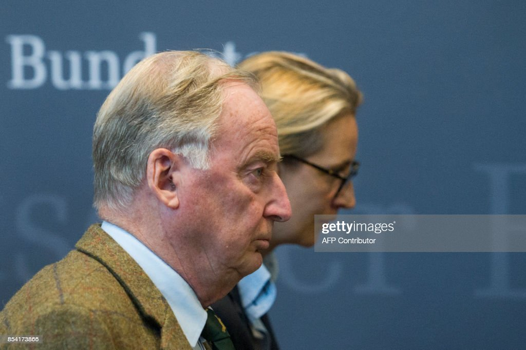 Alice Weidel and Alexander Gauland, newly elected parliamentary party leaders of the hard-right Alternative for Germany (AfD) party, leave after making a statement after a first meeting of the AfD's parliamentary group at the Marie-Elisabeth-Lueders-Haus parliamentary building in Berlin on September 26, 2017, two days after general elections. /