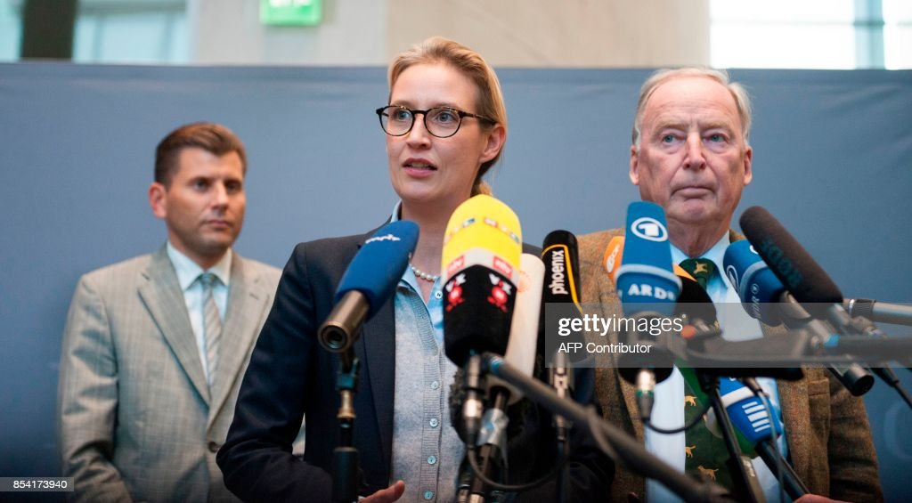 Alice Weidel and Alexander Gauland, newly elected parliamentary party leaders of the hard-right Alternative for Germany (AfD) party, make a statement after a first meeting of the AfD's parliamentary group at the Marie-Elisabeth-Lueders-Haus parliamentary building in Berlin on September 26, 2017, two days after general elections. /