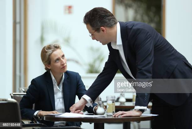 Alice Weidel and Marcus Pretzell who are leading members of the populist Alternative for Germany political party prepare to speak to the media the...
