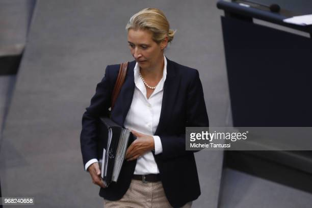 Alice Weidel Co Chairwoman of the AfD Right Party arrives in the plenary Hall as German Chancellor Angela Merkel responds to questions from...