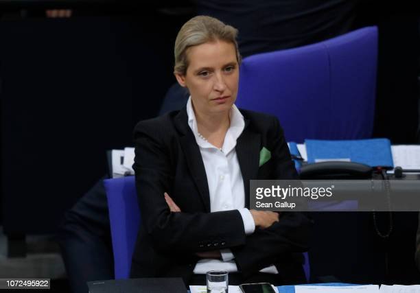 Alice Weidel coBundestag faction leader of the rightwing Alternative for Germany political party sits down after she spoke during debates over the...