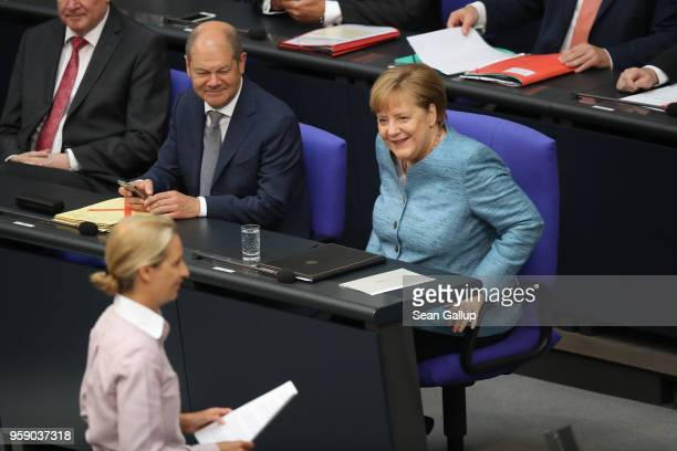 Alice Weidel coBundestag faction leader of the rightwing Alternative for Germany arrives to address the Bundestag as German Chancellor and leader of...