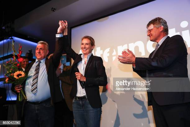 Alice Weidel colead candidate of the Alternative for Germany and Joerg Meuthen celebrate after the announcement of the initial results that give the...