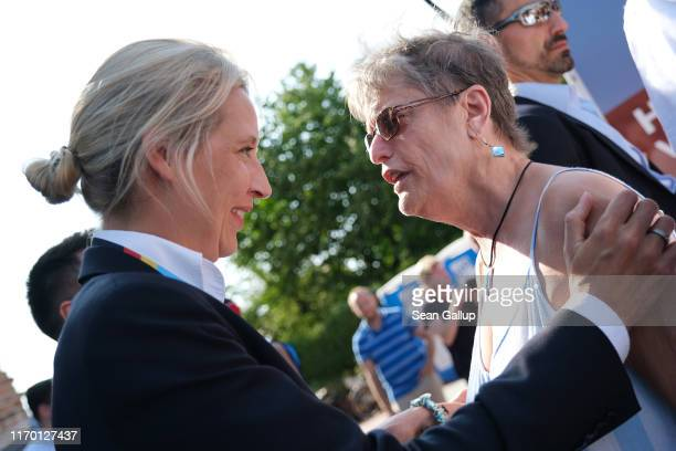 Alice Weidel , co-leader of the Bundestag faction of the right-wing Alternative for Germany political party, greets a supporter while campaigning for...