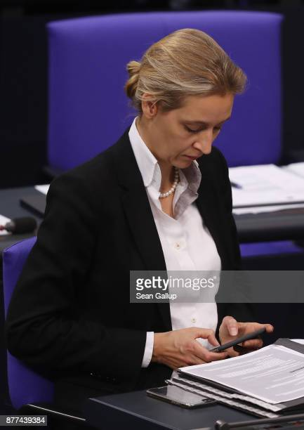 Alice Weidel of the rightwing Alternative for Germany political party types on a smartphone as she attends a Bundestag session on November 22 2017 in...
