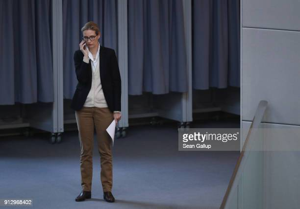 Alice Weidel of the rightwing Alternative for Germany political party speaks on a mobile phone as she attends debates at the Bundestag over a...