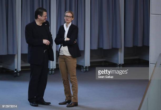 Alice Weidel of the rightwing Alternative for Germany political party speaks with fellow AfD member Stephan Brandner during debates at the Bundestag...
