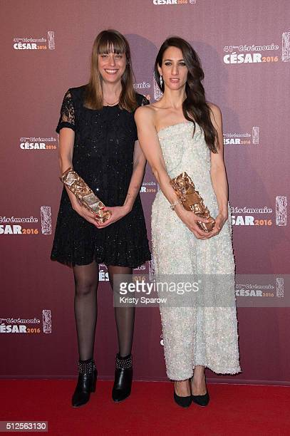 Alice Winocour and Deniz Gamze Erguven pose with their award for Best Script and Best Feature Film for the movie 'Mustang' during The Cesar Film...