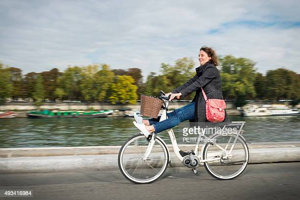 Alice with the electric bike poses on october 03 2015 in Paris France
