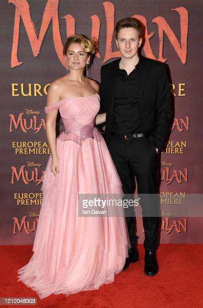 Alicia Agneson and guest attend the European Premiere of Disney's MULAN at Odeon Luxe Leicester Square on March 12 2020 in London England
