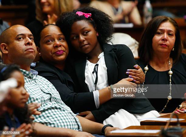 Alicia Cacho of Dorchester second from left hugs Gwendolyn Castro of Dorchester whose grandmother Gricelda E Garo James was killed on 9/11 as they...