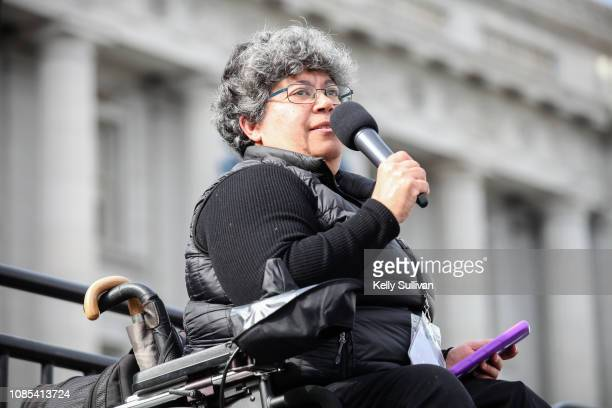 Alicia Contreras Executive Director for the Spanish Speaking Citizens' Foundation speaks onstage at the Women's March San Francisco in Civic Center...