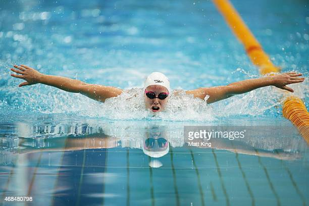 Alicia Coutts competes in the Women's 100m Butterfly Semi Final during day one of the Australian National Swimming Championships at Sydney Olympic...