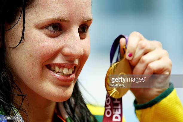 Alicia Coutts of Australia poses with the gold medal during the medal ceremony for the Women's 100m Freestyle Final at the Dr SP Mukherjee Aquatics...