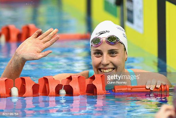 Alicia Coutts of Australia waves to the crowd after winning in the Women's 200 Metre Individual Medley during day four of the Australian Swimming...