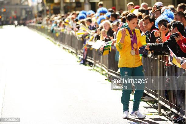 Alicia Coutts signs autographs during the Australian Olympic Team Homecoming Parade in the Sydney CBD on August 20 2012 in Sydney Australia