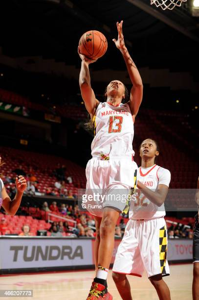Alicia DeVaughn of the Maryland Terrapins shoots the ball against the Delaware State Hornets at the Comcast Center on December 14 2013 in College...