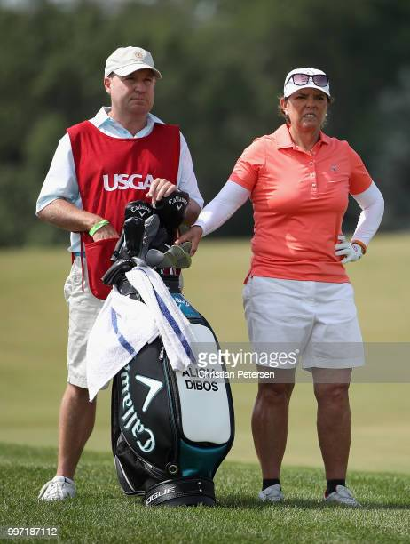 Alicia Dibos of Peru stands with her caddie on the eighth hole during the first round of the US Senior Women's Open at Chicago Golf Club on July 12...