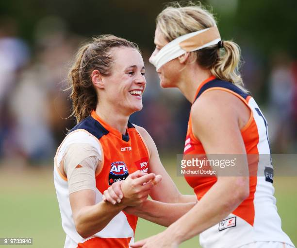 Alicia Eva of GWS and Cora Staunton celebrate the win during the round three AFLW match between the Collingwood Magpies and the Greater Western...