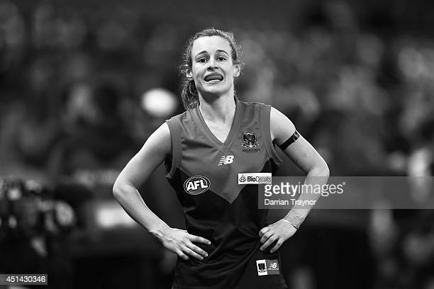 Alicia Eva of Melbourne catches her breath during the women's exhibition AFL match between the Western Bulldogs and the Melbourne Demons at Etihad...