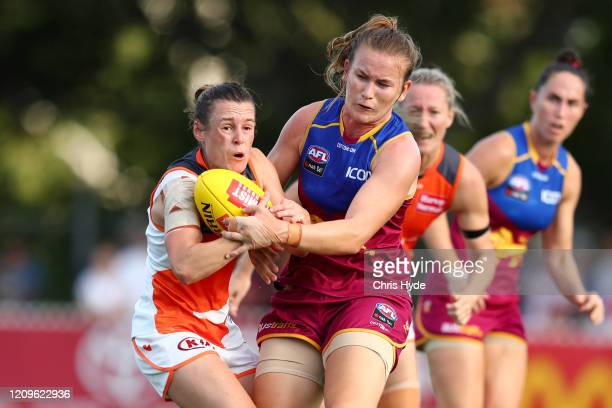 Alicia Eva of the Giants is tackled by Shannon Campbell of the Lions during the round four AFLW match between the Brisbane Lions and the Greater...