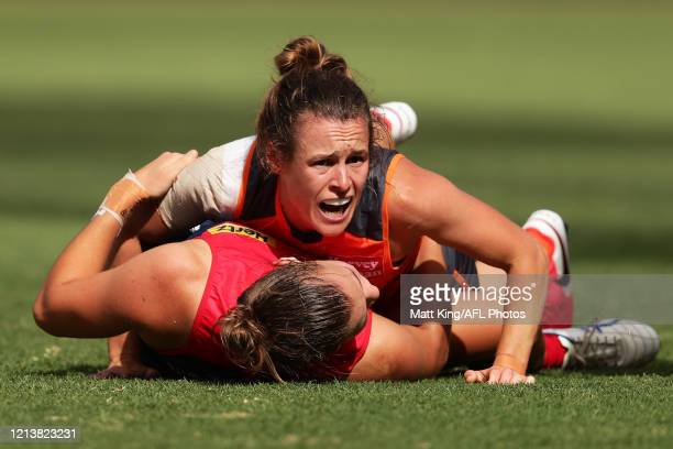 Alicia Eva of the Giants lies on Maddison Gay of the Demons during the AFLW Semi Final match between the Greater Western Sydney Giants and the...