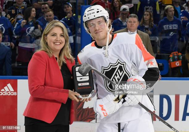 Alicia Jones National Advertising Manager American Honda Motor Co presents Brock Boeser of the Vancouver Canucks a key to a new Honda automobile...