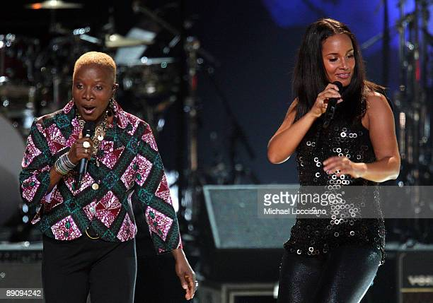 Alicia Keys and Angelique Kidjo perform during the Mandela Day A 46664 Celebration Concert at Radio City Music Hall on July 18 2009 in New York City