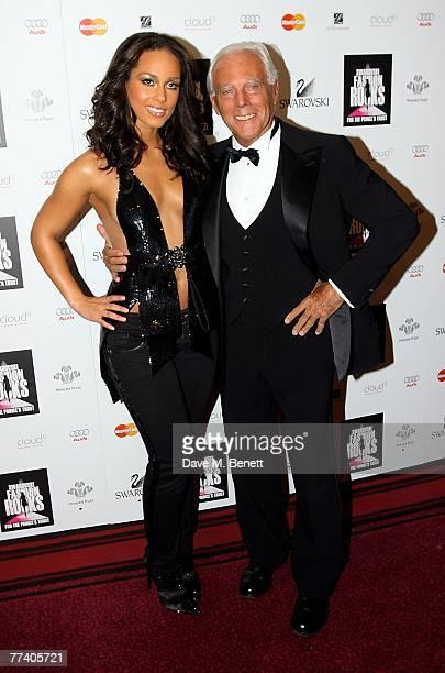 Alicia Keys and Giorgio Armani pose in front of the boards at the Swarovski Fashion Rocks at the Royal Albert Hall on October 18 2007 in London...