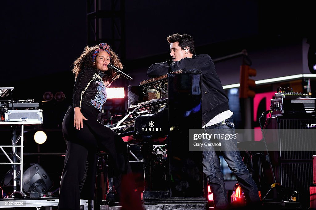 Alicia Keys and John Mayer perform in Times Square on October 9, 2016 in New York City.