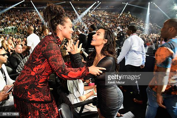 Alicia Keys and Kim Kardashian West share a moment at the 2016 MTV Video Music Awards at Madison Square Garden on August 28 2016 in New York City