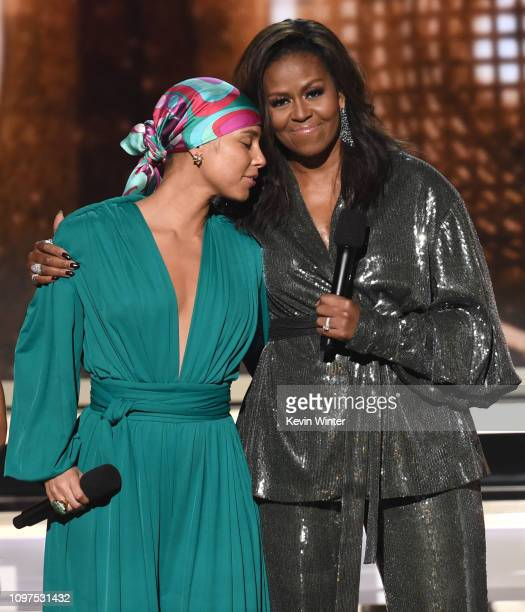Alicia Keys and Michelle Obama speak during the 61st Annual GRAMMY Awards at Staples Center on February 10 2019 in Los Angeles California