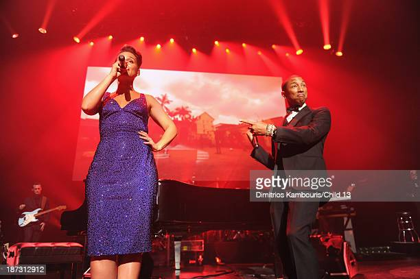 Alicia Keys and Pharrell Williams performs on stage at Keep A Child Alive's 10th Annual Black Ball at Hammerstein Ballroom on November 7 2013 in New...
