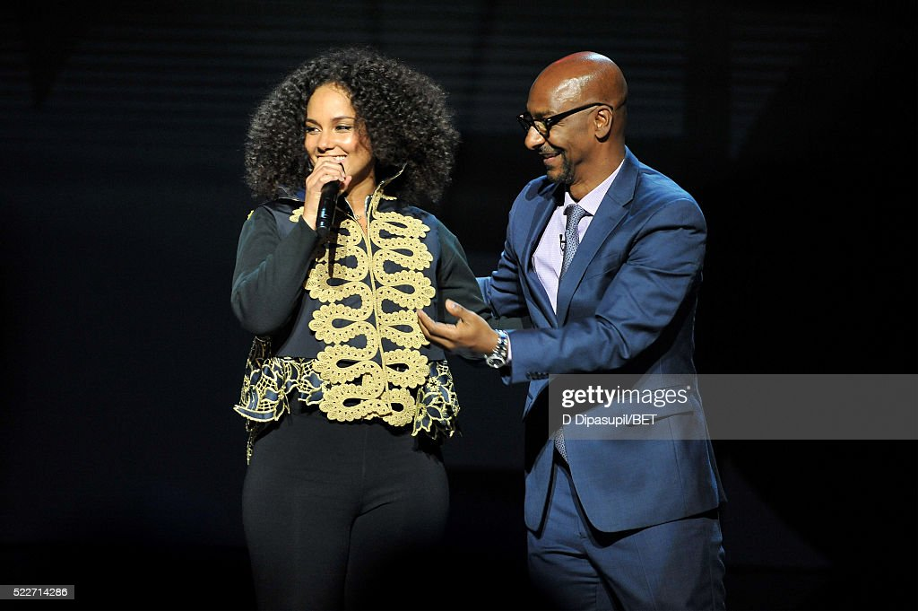 Alicia Keys (L) and President of Programming at BET Networks Stephen G. Hill speak onstage during BET Networks 2016 Upfront at Rose Hall at Jazz at Lincoln Center on April 20, 2016 in New York City.