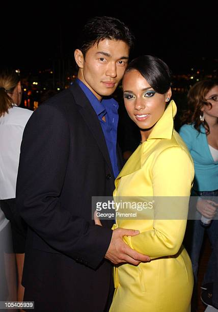 Alicia Keys and Rick Yune during 2004 Cannes Film Festival Budweiser Hosts Alicia Keys Party at The Big Eagle Yacht Port de Cannes in Cannes France