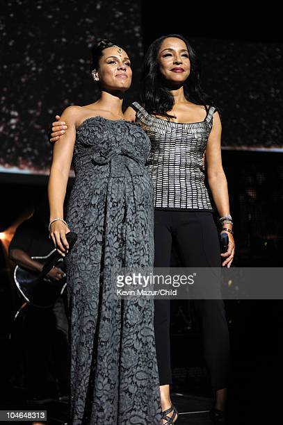 Alicia Keys and Sade perform on stage during Keep A Child Alive's 7th annual Black Ball at Hammerstein Ballroom on September 30 2010 in New York City