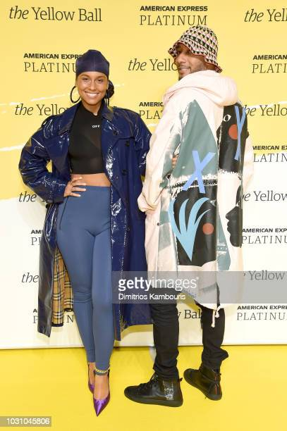 Alicia Keys and Swizz Beatz pose on the Yellow Carpet at the Yellow Ball hosted by American Express and Pharrell Williams at the Brooklyn Museum on...