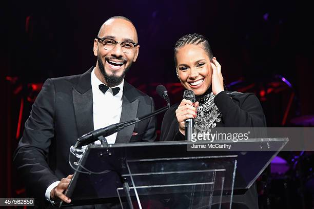 Alicia Keys and Swizz Beatz speak onstage at Angel Ball 2014 hosted by Gabrielle's Angel Foundation at Cipriani Wall Street on October 20 2014 in New...