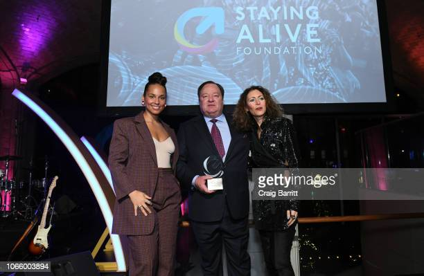 Alicia Keys Bob Bakish and Georgia Arnold pose onstage during the MTV Staying Alive Foundation 20th Anniversary Gala at Guastavino's on November 27...