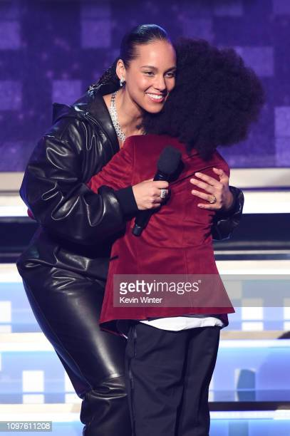 Alicia Keys embraces RaifHenok Emmanuel Kendrick onstage during the 61st Annual GRAMMY Awards at Staples Center on February 10 2019 in Los Angeles...