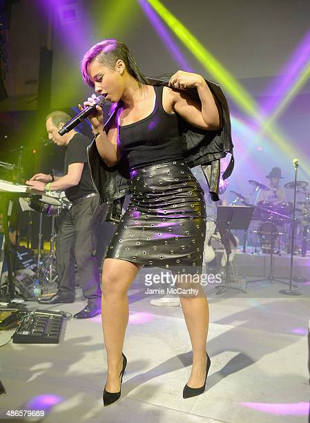 Alicia Keys performs at the after party for The Amazing SpiderMan 2 premiere at Skylight at Moynihan Station on April 24 2014 in New York City