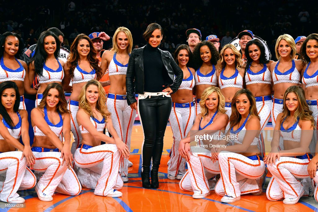 Alicia Keys poses with Knicks City Dancers at half-time of the Miami Heat vs New York Knicks game at Madison Square Garden on November 2, 2012 in New York City.