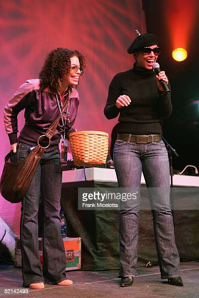 Alicia Keys selects a winner for prizes at the NEXT House Host ESPN The Magazine Alicia Keys Charity Event on February 5 2005 in Jacksonville Florida