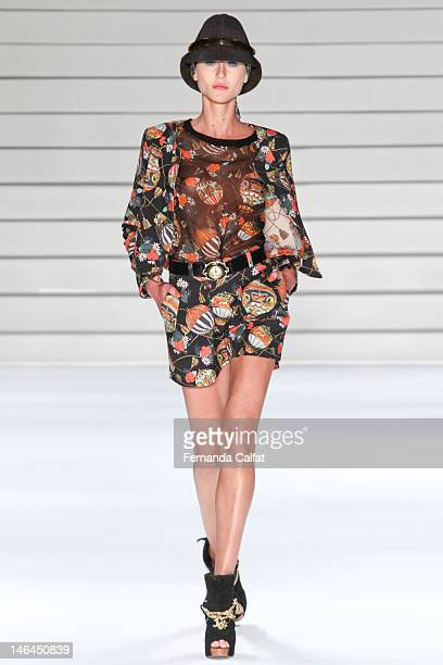 Alicia Kuczman walks the runway during Teca por Helo Rocha show Sao Paulo Fashion Week Spring/Summer 2013 Collections June 16 2012 in Sao Paulo Brazil