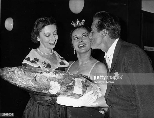 Alicia Markova presents a bouquet to a ballerina who is being kissed by Anton Dolin dancer and choreographer and Artistic Director of the London...