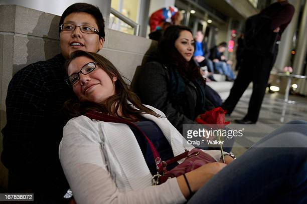 Alicia Martinez leans against her partner Samantha Gomez while waiting to apply for their civil union license at the Webb Building in Denver CO May...