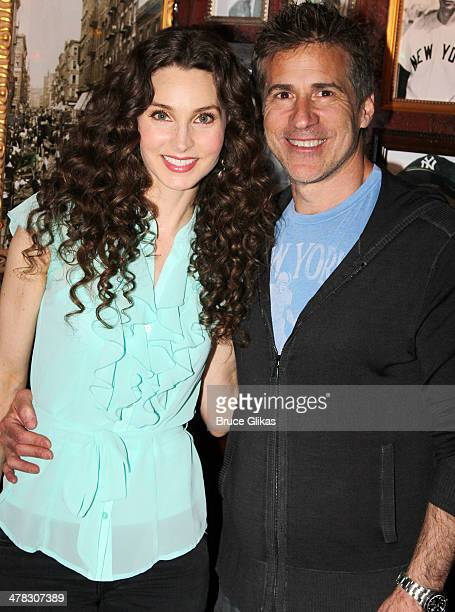 Alicia Minshew and husband Richie Herschenfeld pose as she promotes 'Beacon Hill' at Buca di Beppo Times Square on March 12 2014 in New York City