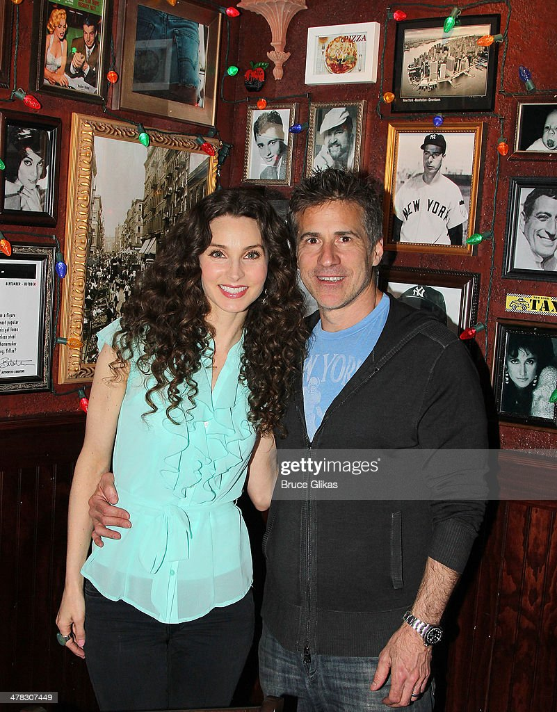 Alicia Minshew and husband Richie Herschenfeld pose as she promotes 'Beacon Hill' at Buca di Beppo Times Square on March 12, 2014 in New York City.